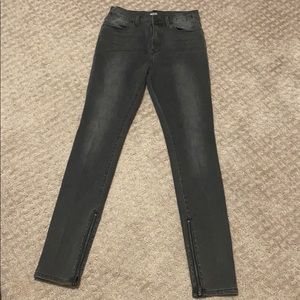 Black high-waisted skinny jeans with zippers